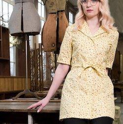 Model wearing day dress.