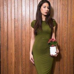 Model wearing green Asymm Pleat Dress.